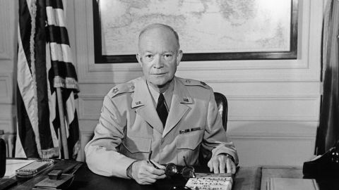 """The former Commander in chief of the Allied forces in Europe (1943) and the future US President General Dwight David """"Ike"""" Eisenhower (1890-1969) poses for a photographer in 1951 at NATO Paris headquarters."""