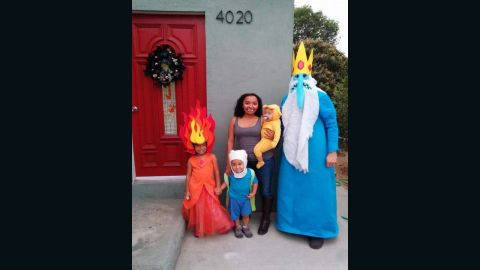 """The family dressed up as """"Adventure Time"""" characters for Halloween in 2014."""