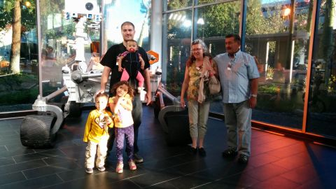 Natalie photographs the family and Daniel's parents taking a tour of NASA's Jet Propulsion Laboratory.