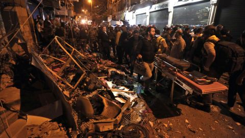 """Emergency personnel and civilians gather at the site of a <a href=""""http://www.cnn.com/2015/11/16/middleeast/beirut-explosions/"""" target=""""_blank"""">twin suicide bombing</a> in Beirut, Lebanon, on Thursday, November 12. The bombings killed at least 43 people and wounded more than 200 more. ISIS appeared to claim responsibility in a statement posted on social media."""