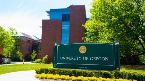 EUGENE, OR - APRIL 29, 2014: University of Oregon campus entrance sign next to a walkway at the school.