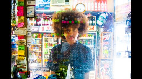 """For 15 years, Hatnim Lee has been photographing customers at her parents' liquor store in Washington. She calls her portrait series """"Plexiglass."""""""