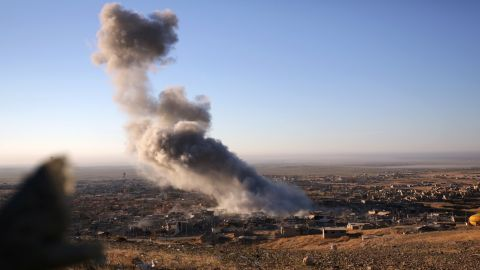 """Smoke rises over the northern Iraqi town of Sinjar on November 12. Kurdish Iraqi fighters, backed by a U.S.-led air campaign, <a href=""""http://www.cnn.com/2015/11/13/middleeast/iraq-free-sinjar-isis/"""" target=""""_blank"""">retook the strategic town, </a>which ISIS militants overran last year. ISIS wants to create an Islamic state across Sunni areas of Iraq and Syria."""