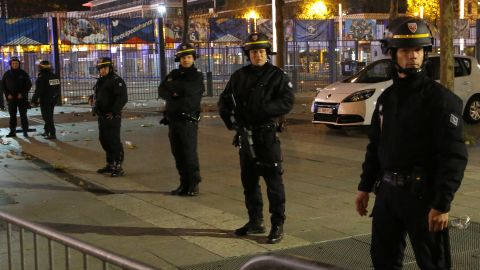 Police secure the Stade de France in Saint-Denis, north of Paris, following explosions during the soccer match between France and Germany.