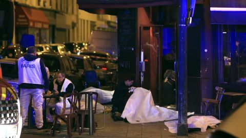 Victims lay on the pavement outside a Paris restaurant.