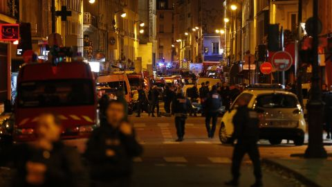 Police, firefighters and rescue workers secure the area near the Bataclan concert hall on November 14.
