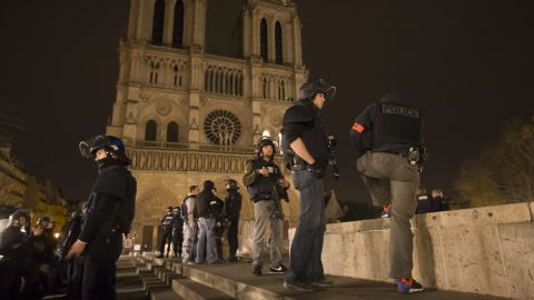 Police officers patrol the area around Notre Dame cathedral in Paris on November 14.