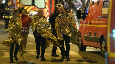 Security forces evacuate people on Rue Oberkampf near the Bataclan concert hall early on November 14.