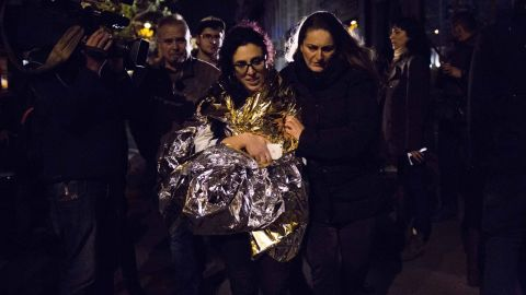 A survivor of the terrorist attack in the Bataclan is assisted following terror attacks, November 13. The violence at the Bataclan, which involved a hostage-taking, resulted in the highest number of casualties of all the attacks.