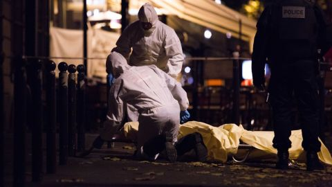 """Forensics are working in the street of Paris after the terrorist attack on Friday, November 13.  The words """"horror,"""" """"massacre"""" and """"war"""" peppered the front pages of the country's newspapers, conveying the shell-shocked mood."""