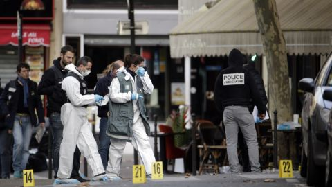 Forensic scientists inspect the Cafe Bonne Biere on Rue du Faubourg du Temple in Paris on Saturday, November 14 following a series of coordinated attacks in and around Paris late Friday.
