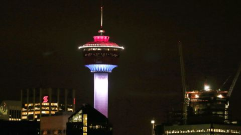 The Calgary Tower in Alberta, Canada, is lit up with the colors of the French flag on Friday, November 13.