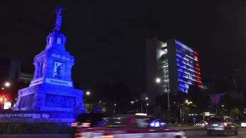The Senate building in Mexico City is lit up blue, white and red on November 13.