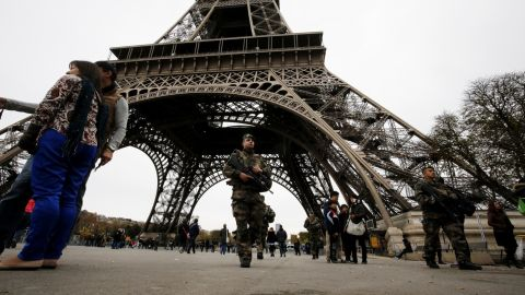 Soldiers patrol the Eiffel Tower on November 14.