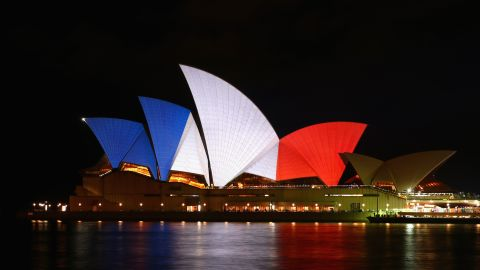 """<a href=""""http://www.cnn.com/2015/11/14/world/paris-attacks-tributes-irpt/index.html"""">As a sign of solidarity</a>, Australia's Sydney Opera House is illuminated in the colors of the French flag on November 14."""