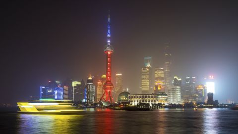 A ferry travels past the Oriental Pearl Tower in Shanghai, China, on November 14.