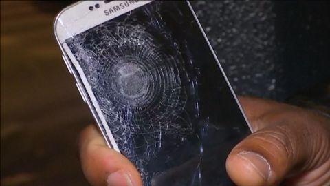 paris attack survivor cell phone saved shrapnel sot_00000000.jpg