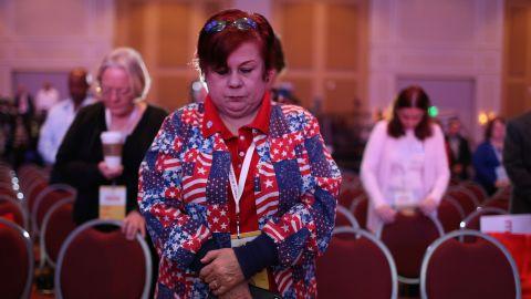 Nancy Acevedo prays for France during the opening prayer for the Sunshine Summit being held at Rosen Shingle Creek in Orlando, Florida on November 14.