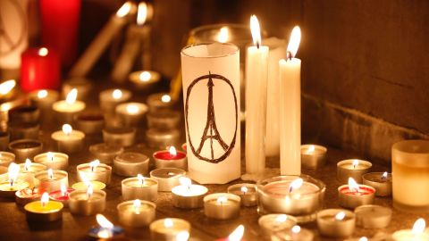 Candles are lit in Hong Kong on November 14 to remember the scores who died in France.