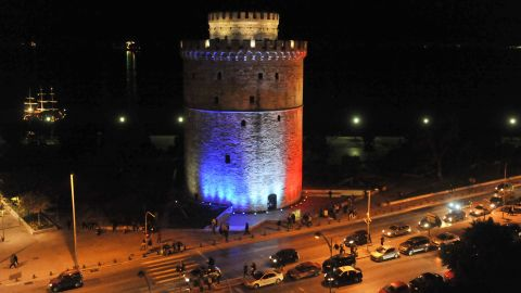 The White Tower, a symbol of the Greek city of Thessaloniki, is lit with the colors of the French national flag on November 14.
