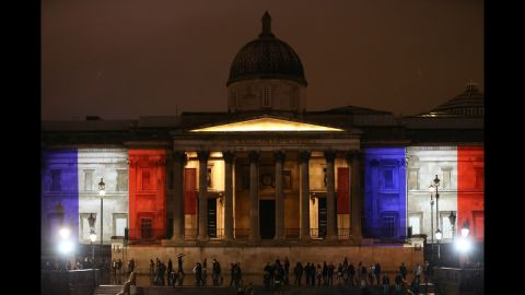 London's National Gallery is illuminated in blue, white and red lights on November 14.