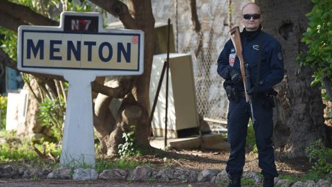 A French police officer guards the French-Italian border on November 14 in Menton, France.