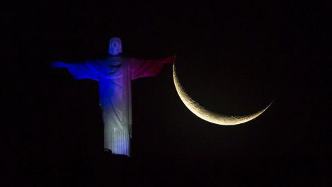 The Christ the Redeemer statue in Rio de Janeiro is illuminated in French national colors on November 14.