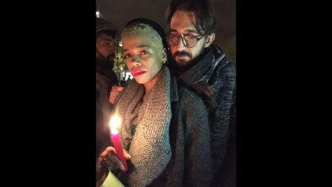"""Vigils are being held across Paris in the aftermath of the terror attacks that took more than 125 lives on Friday, November 13. Photographer <a href=""""http://www.gillianlaub.com/"""" target=""""_blank"""" target=""""_blank"""">Gillian Laub</a> met people who were out honoring the victims and reflecting on the tragedy the next day. Among them were 30-year-old Paquita Mboni, left, and Laurent Farre, 40, at the Place de la Republique square. """"In the United States I don't know if this would have happened,"""" Farre said. """"People would have been able to defend themselves because they are allowed to carry guns. We aren't, so we are defenseless. But we won't give in to fear. It's not an option."""""""