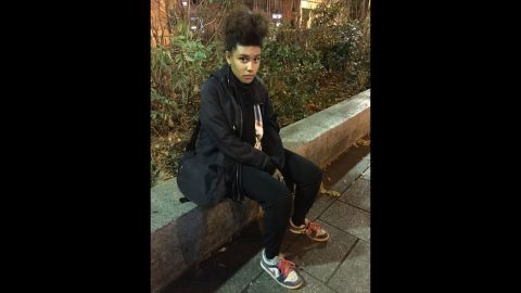 """""""I came here with my mom tonight to take photos and to show that we are here and not scared,"""" said Maboliaa, 16. """"It is my rebellion. I couldn't sit home and do nothing. ... I almost went to the concert (at the Bataclan) last night and now I am grateful my parents didn't let me."""""""