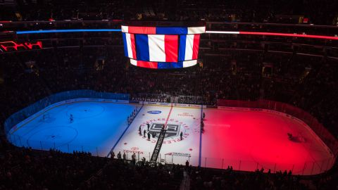 The Staples Center's ice is lit up with the colors of the French flag before the start of an NHL hockey game on November 14.