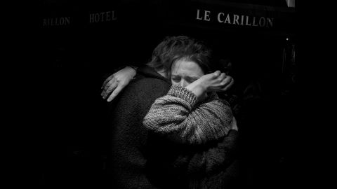 """The day after the terror attacks in Paris on Friday, November 13, Magnum photographer Alex Majoli photographed the range of responses to the tragedy. This image of two people embracing and crying in front of Le Carillon, the bar where gunmen drove by and opened fire with Kalashnikov-type assault rifles, is especially important to him. """"Many times when I come to Paris ... that is the bar where usually I have my last drink before I go to bed,"""" Majoli said.<br />"""
