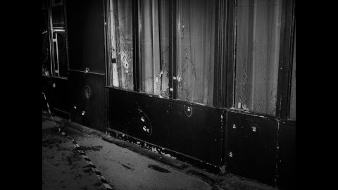 Majoli says photographing the aftermath allowed him to organically react to what was taking place and observe others all around him -- inside and outside Paris. This image of bullet holes was taken in front of Le Carillon and Le Petit Cambodge, two restaurants that were attacked. <br />