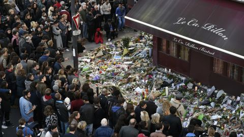 """People gather at a makeshift memorial in front of """"Le carillon"""" restaurant on November 16, 2015, in the 10th district of Paris, following a series of coordinated terrorists attacks on November 13. Islamic State jihadists claimed a series of coordinated attacks by gunmen and suicide bombers in Paris that killed at least 128 people in scenes of carnage at a concert hall, restaurants and the national stadium. AFP PHOTO / ALAIN JOCARD        (Photo credit should read ALAIN JOCARD/AFP/Getty Images)"""