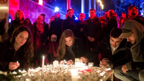 People light candles in tribute to the Paris victims on November 15 in Budapest, Hungary.