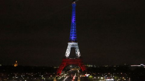 The Eiffel Tower is illuminated in the French national colors red, white and blue in honor of the victims of the terror attacks last Friday in Paris, Monday, Nov. 16, 2015.  France is urging its European partners to move swiftly to boost intelligence sharing, fight arms trafficking and terror financing, and strengthen border security in the wake of the Paris attacks. (AP Photo/Frank AugsteinAP)
