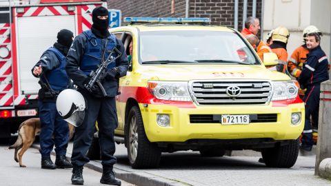 Armed police guard a street in Molenbeek on November 16.