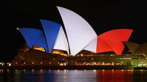 SYDNEY, AUSTRALIA - NOVEMBER 14:  The sails of the Sydney Opera House are illuminated in the colours of the French flag on November 14, 2015 in Sydney, Australia. At least 120 people have been killed and over 200 are injured in Paris following a series of terrorist acts in the French capital on Friday.  (Photo by Cameron Spencer/Getty Images)
