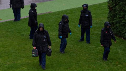 Police officers conduct searches of the area surrounding Wembley Stadium.
