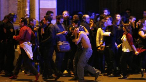 """Wounded people are helped outside the Bataclan concert hall in Paris following a series of coordinated attacks in the city on Friday, November 13. The militant group ISIS claimed responsibility <a href=""""http://www.cnn.com/2015/11/13/world/gallery/paris-attacks/index.html"""" target=""""_blank"""">for the attacks,</a> which killed at least 130 people and wounded hundreds more."""