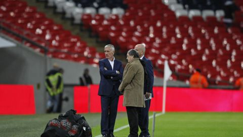 France coach Didier Deschamps is pictured on the pitch before the start of the friendly.