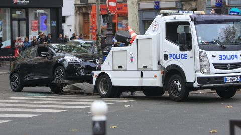 """A Renault Clio with Belgian license plates is towed by the police in Paris on Tuesday, November 17. The car is believed to have been rented by <a href=""""http://www.cnn.com/2015/11/17/europe/paris-attacks-at-a-glance/index.html"""" target=""""_blank"""">Salah Abdeslam.</a><a href=""""http://www.cnn.com/2015/11/17/world/paris-attacks/index.htmll"""" target=""""_blank""""> Authorities are looking for Abdeslam,</a> a Belgium-born French national who is one of three brothers suspected in the terror attacks."""
