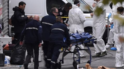 A body is removed from the apartment raided by French Police special forces earlier in the northern Paris suburb of Saint-Denis, on November 18, 2015, hunting those behind the attacks that claimed 129 lives in the French capital five days ago. French police said the assault had concluded on an apartment in northern Paris in which at least two jihadists were killed and seven arrested. AFP PHOTO / ERIC FEFERBERG        (Photo credit should read ERIC FEFERBERG/AFP/Getty Images)