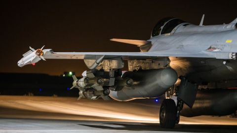 This photo released on Tuesday, Nov. 17, 2015 by the French Army Communications Audiovisual office (ECPAD) shows a French army Rafale jet on the tarmac of an undisclosed air base as part of France's Operation Chammal launched in September 2015 in support of the US-led coalition against Islamic State group. France launched fresh airstrikes on the Islamic State stronghold of Raqqa in Syria days after attacks in Paris linked to the group killed at least 129 people. French military spokesman Col. Gilles Jaron said the strikes destroyed a command post and training camp and come a day after President Francois Hollande vowed to forge a united coalition capable of defeating the jihadists at home and abroad. (Sebastien Dupont/ECPAD via AP) THIS IMAGE MAY ONLY BE USED FOR 30 DAYS FROM TIME TRANSMISSION. MANDATORY CREDIT.