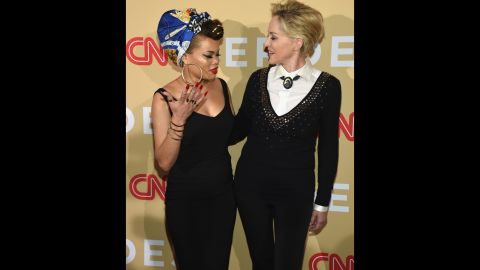 """Singer Andra Day, left, and actress Sharon Stone meet on the red carpet. Day performed her inspiring anthem """"Rise Up"""" during the show. Since 2007, CNN's Peabody Award-winning, Emmy-nominated franchise has profiled more than 250 Heroes and received more than 50,000 nominations from more than 100 countries."""