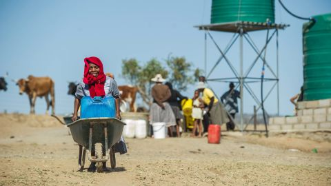 Residents of Nongoma, north west of Durban, that has been badly affected by the recent drought, prepare to collect water from a free water point sponsored by concerned citizens.