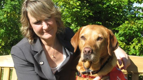 """Claire Guest is the CEO of Medical Detection Dogs, a company that trains dogs to sniff out cancer. Her fox red Labrador, Daisy, caught her breast cancer six years ago when she was 45. """"She kept staring at me and lunging into my chest. It led me to find a lump,"""" Guest remembers."""