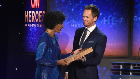 """2015 CNN Top 10 Hero Monique Pool receives her award from presenter Neil Patrick Harris. Pool -- nicknamed """"The Sloth Lady"""" -- was honored for her remarkable work with animals in Suriname."""
