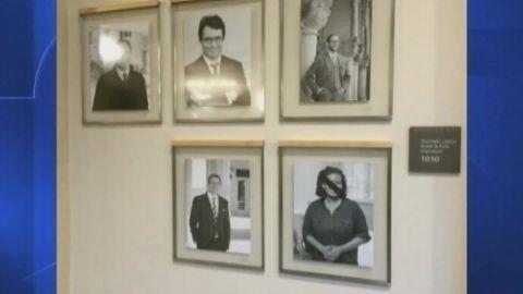 tape placed over black harvard professor portraits pkg _00001102.jpg