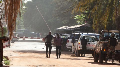 Security forces escort a man from the hotel on November 20.