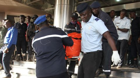 """Officers evacuate bodies of victims from the Radisson Blu hotel in Bamako on November 20, 2015, after the assault of security forces. Malian forces backed by French troops stormed the Radisson Blu hotel in the capital Bamako after suspected Islamist gunmen seized guests and staff in a nine-hour hostage crisis that left at least 18 people dead. UN Secretary-General Ban Ki-moon condemned the """"horrific terrorist attack"""" on November 20, and indicated the violence was aimed at destroying peace efforts in the country. AFP PHOTO / HABIBOU KOUYATE        (Photo credit should read HABIBOU KOUYATE/AFP/Getty Images)"""